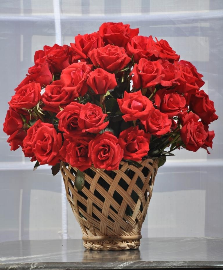 Red Roses in a Beautiful Cane Vase