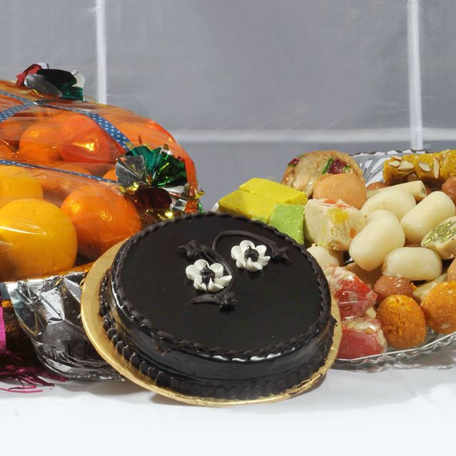 Fruits With Mithai And Cake